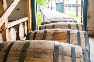 Bourbon Barrels rolling out of a building