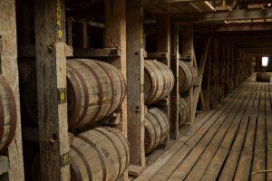 rickhouse bourbon barrels stacked in rick house