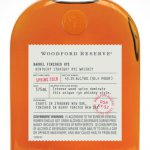Woodford bottle with light color bourbon and white background