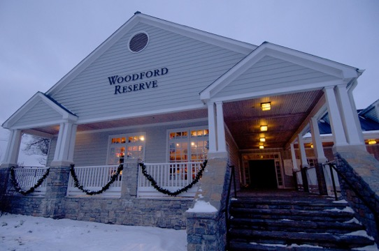 Woodford Reserve building in the evening with snow and garland
