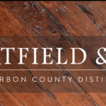 hartfield and co logo with wood in the background