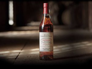 one bottle of pappy van winkle with a blurry background