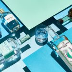 spirits: blue background with 6 bottles of alcohol and one glass in the middle