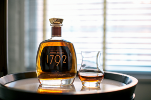 bottle of 1792 bourbon and a glass with some bourbon