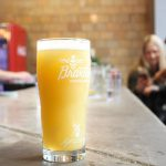 Valentine's Day: a beermosa in a clear glass on a bar