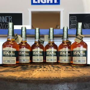 closing: 6 bottles of bourbon on a barrel