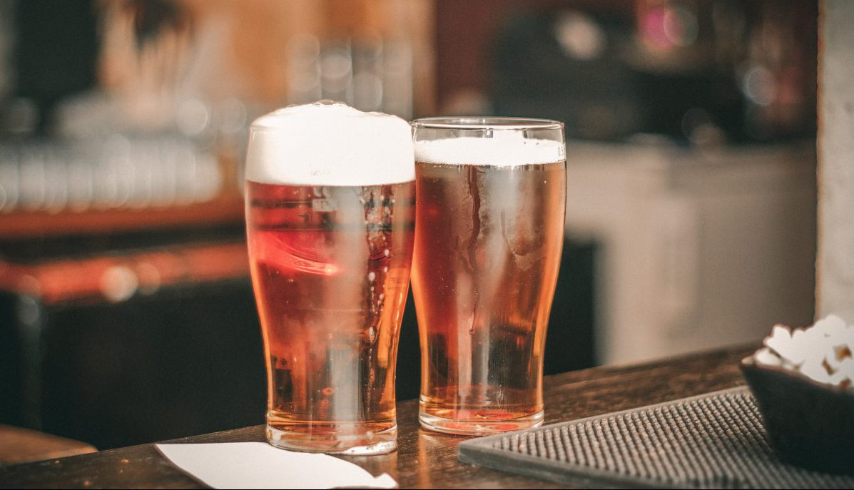 louisville brewery: two glasses of beer on a bar