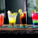 drink for you: 4 colorful cocktails on a wooden bar