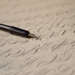 whisky: a fountain pen on a sheet of paper with calligraphy