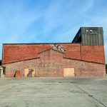 unique style: an old brick building with some graffiti