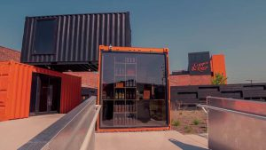 unique style: black and orange shipping containers with glass doors