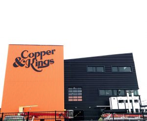 unique style: black and orange building that says copper & kings
