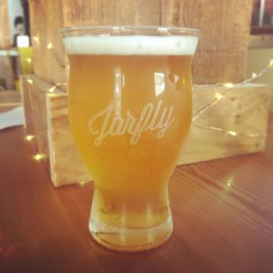 somerset: glass of a light beer on a table that says jarfly