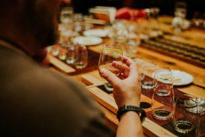 bourbon affair: man holding a small bourbon glass