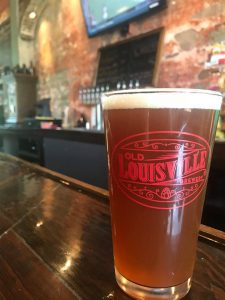 louisville brewery: medium beer in a glass that says old louisville brewery on a bar