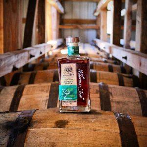 distillery: bottle of wilderness trail on bourbon barrels