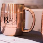 Bourbon Women: copper cup with BW on it