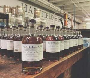 Bourbon County: many bottles of bourbon on a wooden bar