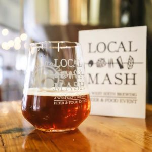 West Sixth: glass that says local mash with beer in it