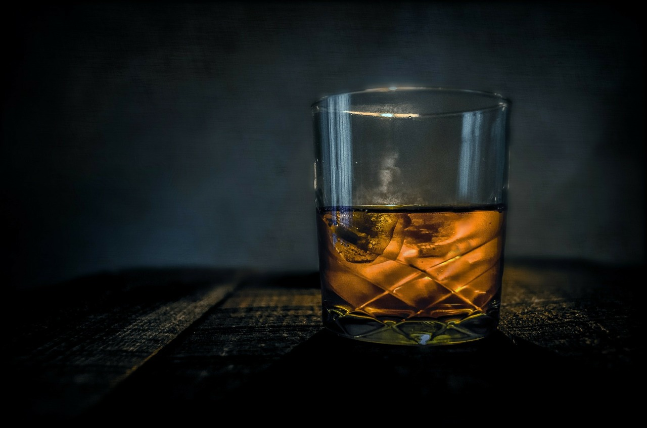 Distillery of the Year liquor barn Whiskey: glass on a dar wooden bar with a dark background