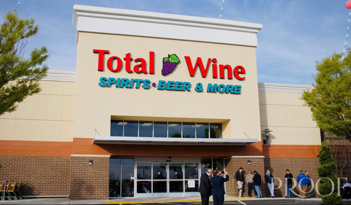 A building that says Total Wine with a line out the door
