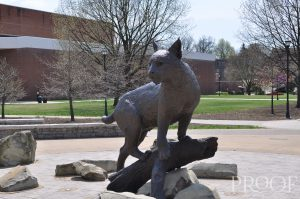 Jim Beam: a statue of a wildcat perched on a rock