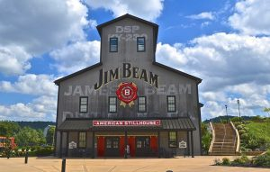 a building that says Jim Beam with blue sky