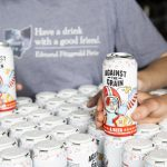 Against the Grain: beer in a white can with a person in a gray shirt