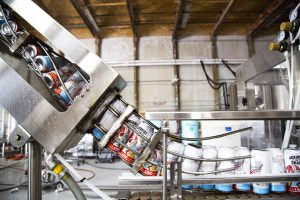 Against the Grain: cans in an assembly machine