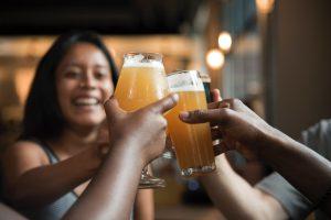 Craft Beer: group of people cheersing with beer