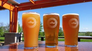 Brewery: three glasses that say country boy brewing with beer in them