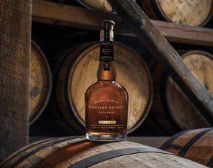 Batch Proof: bourbon bottle on a barrel
