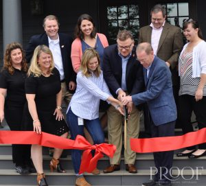 Woodford Reserve: group of people cutting a red ribbon