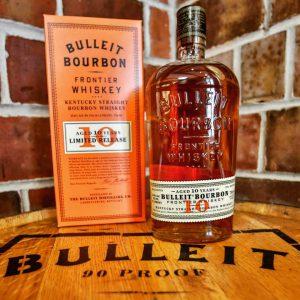 Bulleit Distilling: a bottle of bourbon on a barrel