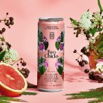 Sparkling Cocktail: a pink can with a grapefruit and flowers surrounding it and a pink background