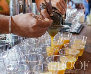 Castle & Key: hands pouring a drink in little clear cups