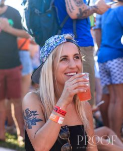 Forecastle: a girl in a hat drinking a pink dirnk