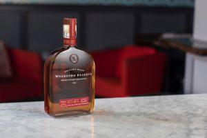 Whiskey: bottle of a dark liquid on a marble bar