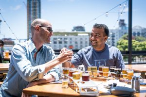Kentucky Proud: two men sitting at a table drinking samples of beer