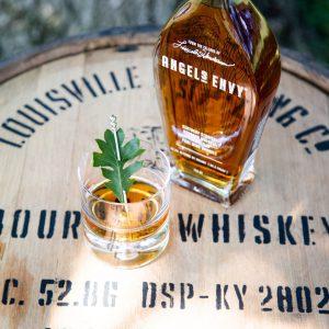 kentucky: bourbon bottle and glass on a barrel