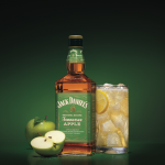 Tennessee Apple: bottle with a green lable, a glass, and apple next to it