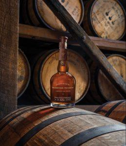 bourbon bottle on a bourbon barrel