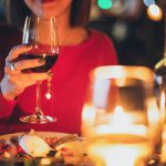 Woodford: woman in a red dress with food and a glass of wine in her hand